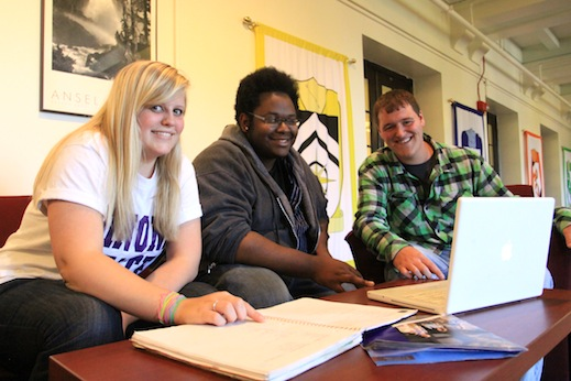 Students work on a group project in Lourdes hall.