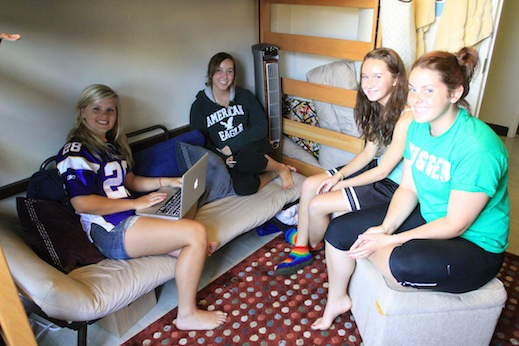 Students hang out in a dorm room in the Tau Center.