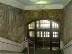The section of the John Martin Socha mural over the Somsen doors features the fronteirsmen and Indians coming together in peace.