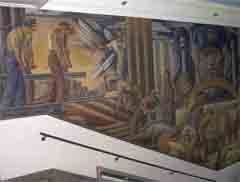 This wall of John Martin Socha�s mural features early settlers taming the wilderness of the Winona area, creating a community.