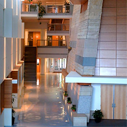 : The SLC Atrium is a common space that connects the science halls. It features geological elements of the area and works of art.