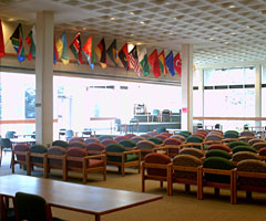 The Baldwin Lounge features a naturally lit space with lots of comfy chairs. International flags hang above the lounge.